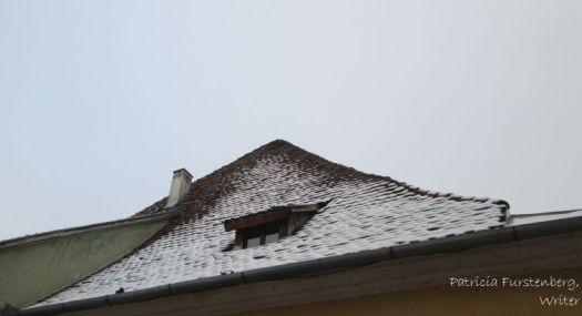 Sighisoara - slanted roof and a peep-window