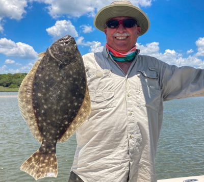 man with caught flounder in florida