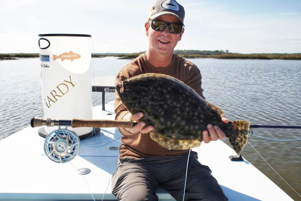Man holding a southern flounder in Florida.