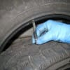 Measuring the tread depth on a tire, Subaru