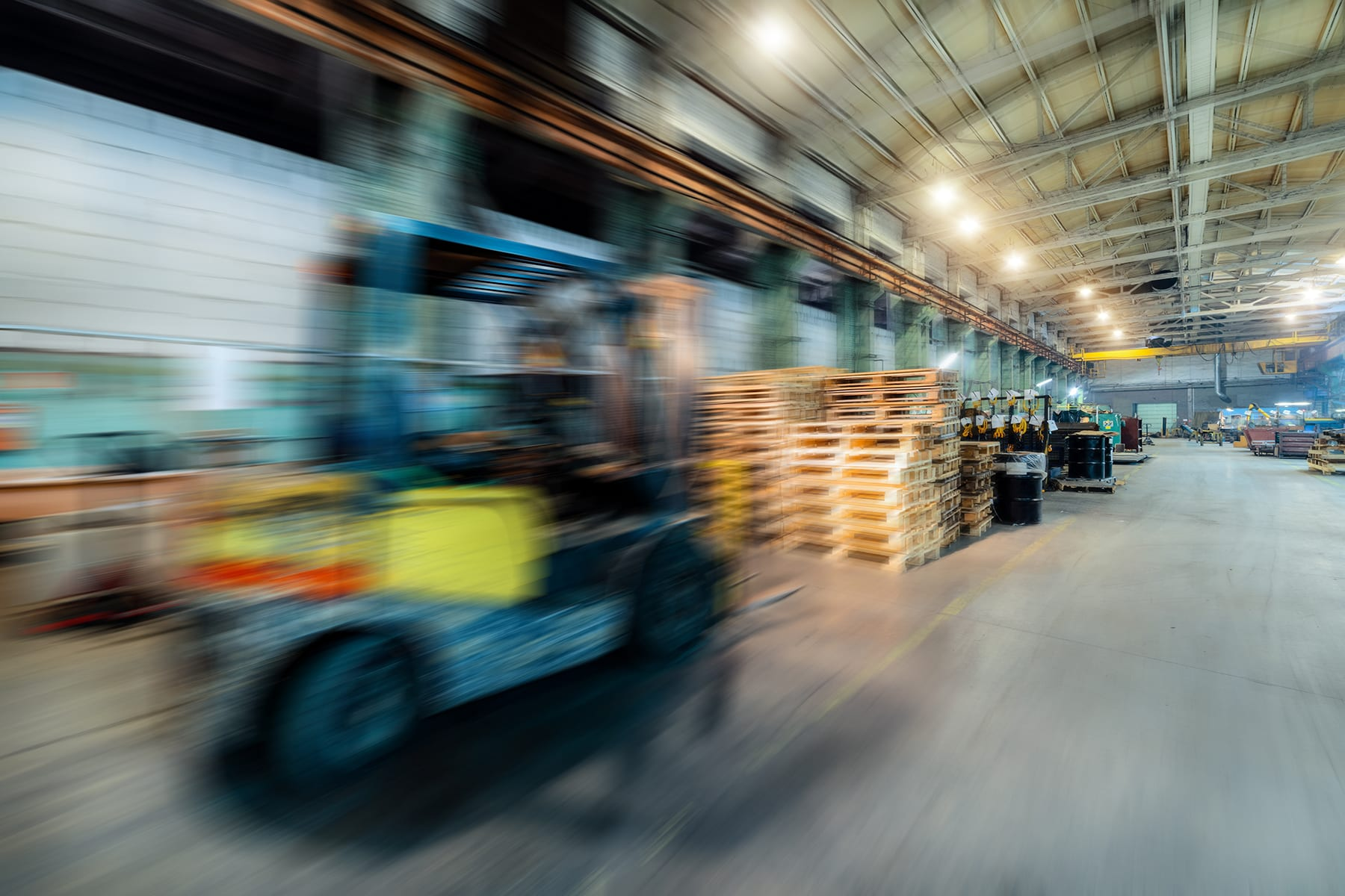 blur image of forklift in warehouse