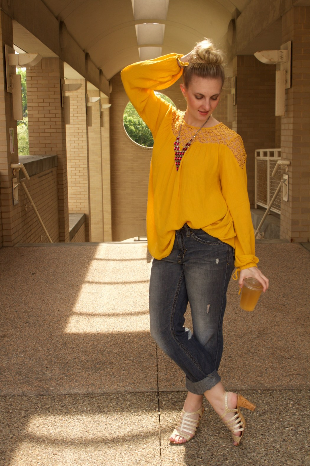 boy friend jeans, yellow crochet blouse, Passiana red pyramid necklace | styled by Allyn Lewis