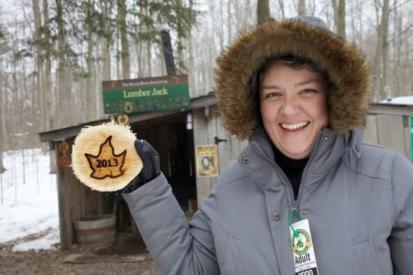 Jody holding branded wood cut