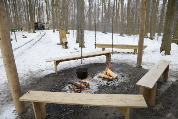 Fire pit with cauldron of syrup