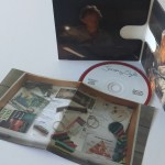 The interior of the album features a still from the set of music videos. The booklet cover is a picture of the inside of a drawer. The disc is designed in the same vein as the album front cover.