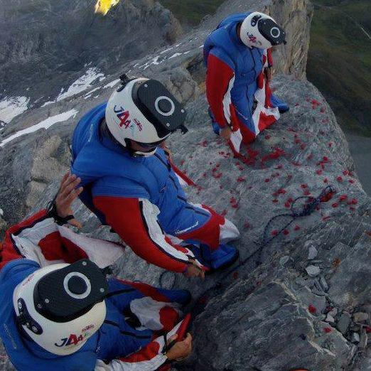 Jump4Heroes stood on the edge of the Eiger, bowing heads in memory of the fallen before leaping off and flying a wingsuit human flight formation.