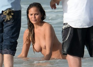 EXCLUSIVE: **PREMIUM RATES APPLY**NO WEB UNTIL 4PM EST MARCH 12 2015** INF - Chrissy Teigen gets naked during a photo shoot with her husband John Legend in Miami Beach.