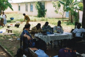 Beng youth meeting, Abidjan - Philip at table with guys, 6-13-93