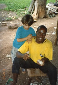 Kofi Ba carves statue, Nathaniel watches, 8-2-93