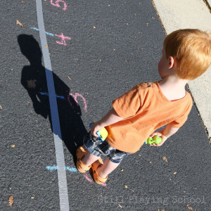Boy Measures Own Shadow