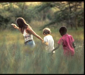 Colin and Sadiki Running in the Tall Grass w Perry Gilmore