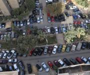 الجيزة : تطوير شارع سليمان أباظة بعد تحويله لساحة انتظار السيارات
