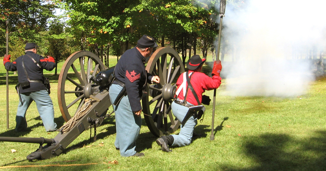 Civil War re-enactors fire cannons at the Wilder Homestead