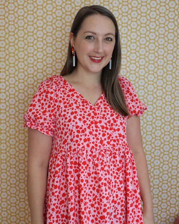 almond rock in a pink and red print version of m7969 buffet dress surplice bodice with gathered skirt and puff sleeves