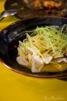 Stir fried squid with white asparagus and prawn butter
