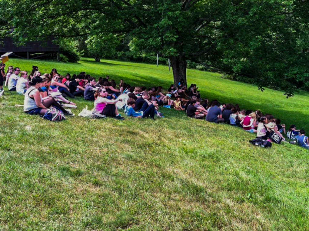 Hillside announcements with counsellors and campers at Camp Ballibay Performing Arts Camp in Pennsylvania, USA