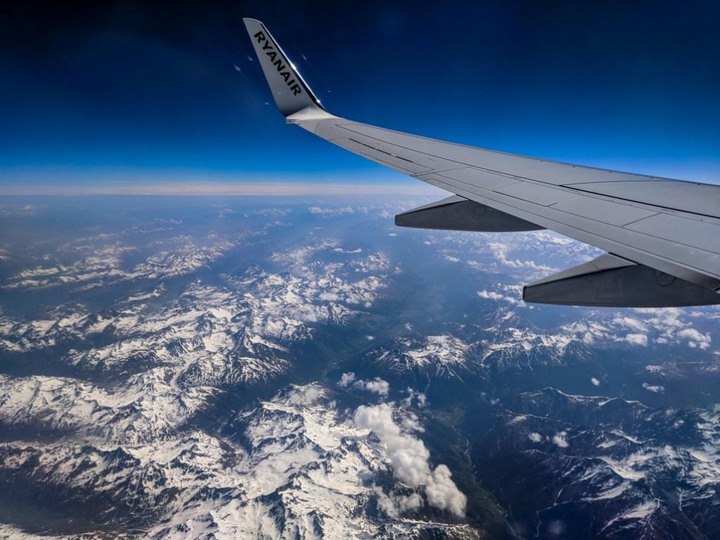 Ryanair plane wing over the Italian Alps