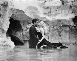 Marcello and Sylvia in the Trevi Fountain in Rome, Italy, one of the La Dolce Vita filming locations