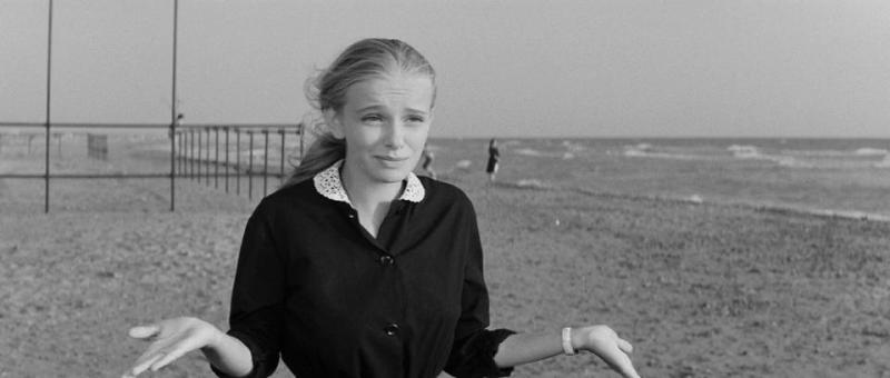 Young girl on a beach in Passo Oscuro, one of the La Dolce Vita filming locations