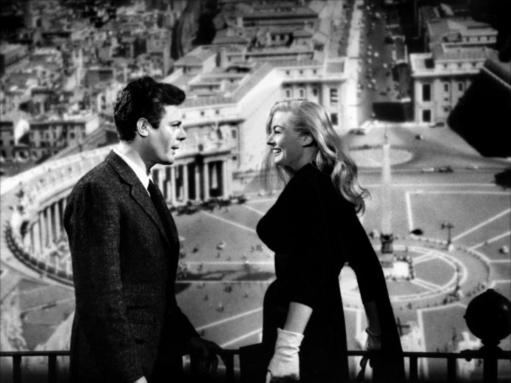 Marcello and Sylvia in the St Peter's Basilica Dome overlooking St Peter's Square in Vatican City, Italy, one of the La Dolce Vita filming locations
