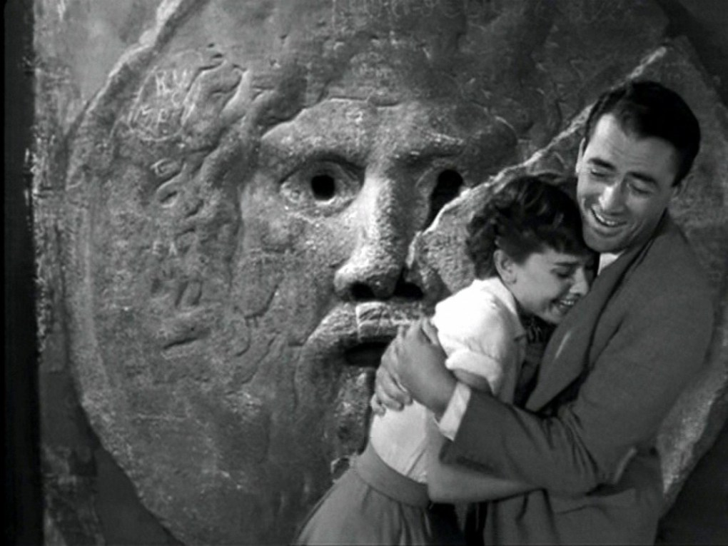 Anne and Joe at the Mouth of Truth in Santa Maria in Cosmedin, Rome in Roman Holiday (1953)