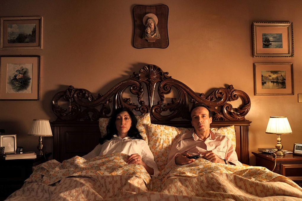 Leopoldo is at home in bed with his wife in To Rome with Love (2012)