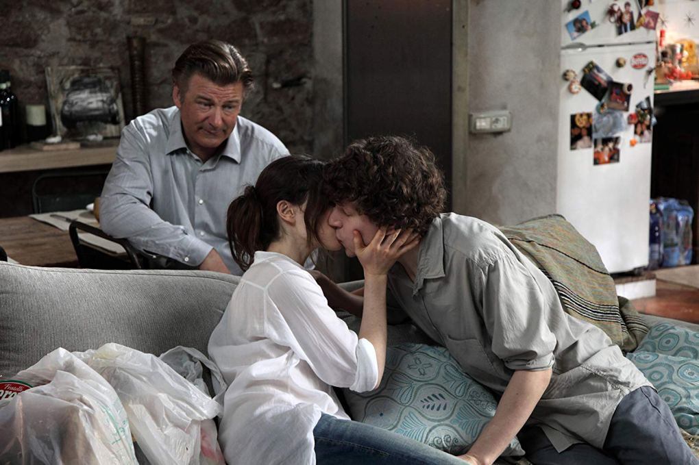 Monica kisses Jack while John looks on in Jack's apartment in in To Rome with Love (2012)