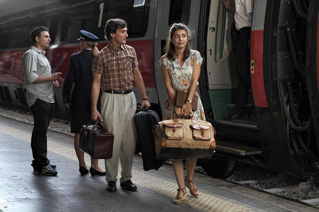 Antonio and Milly depart the train at Roma Termini Station in To Rome with Love (2012)
