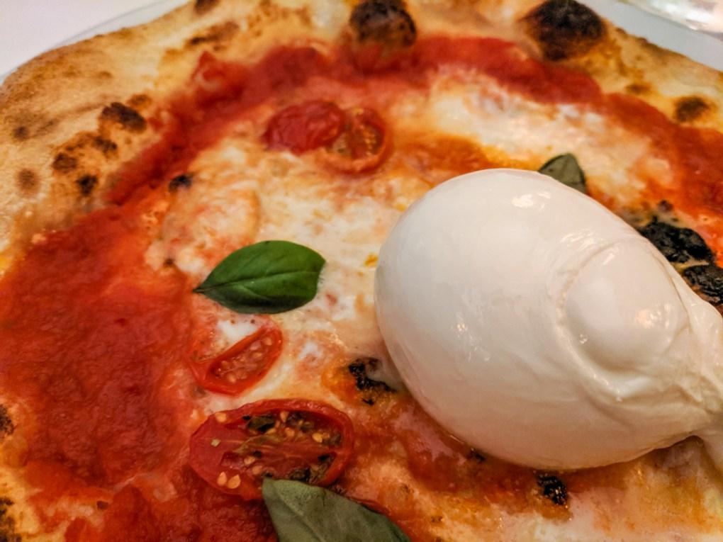 Buffalo mozzerella pizza at Green Tower Ristorante Pizzeria in Trento, Italy