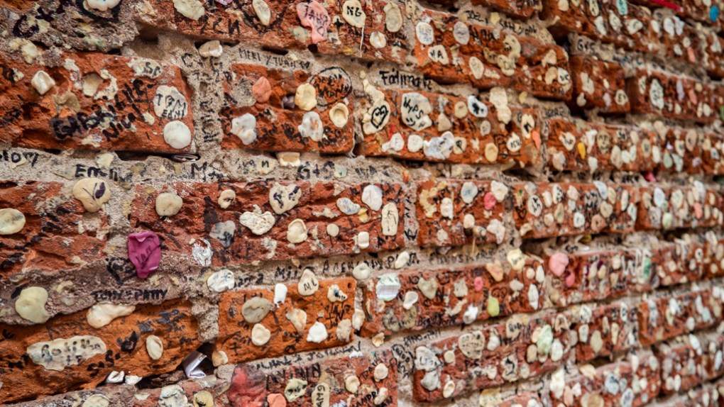 Chewing gum and notes on the walls of Casa di Giulietta in Verona, Italy