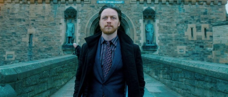 James McAvoy walking away from Edinburgh Castle in the film Filth (2013)