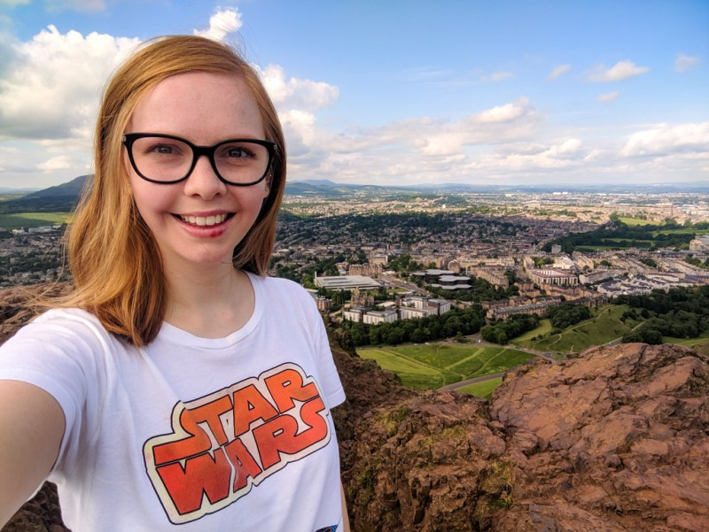 Almost Ginger blog owner on top of Arthur's Seat in Edinburgh, UK