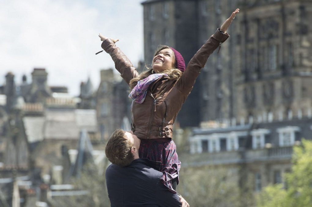 Davy holding up Yvonne from the film Sunshine on Leith (2013)