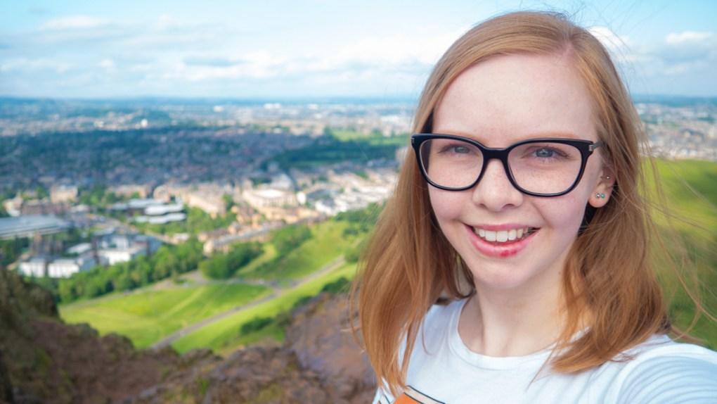 Almost Ginger blog owner on top of Arthur's Seat in Edinburgh   3 Days in Edinburgh