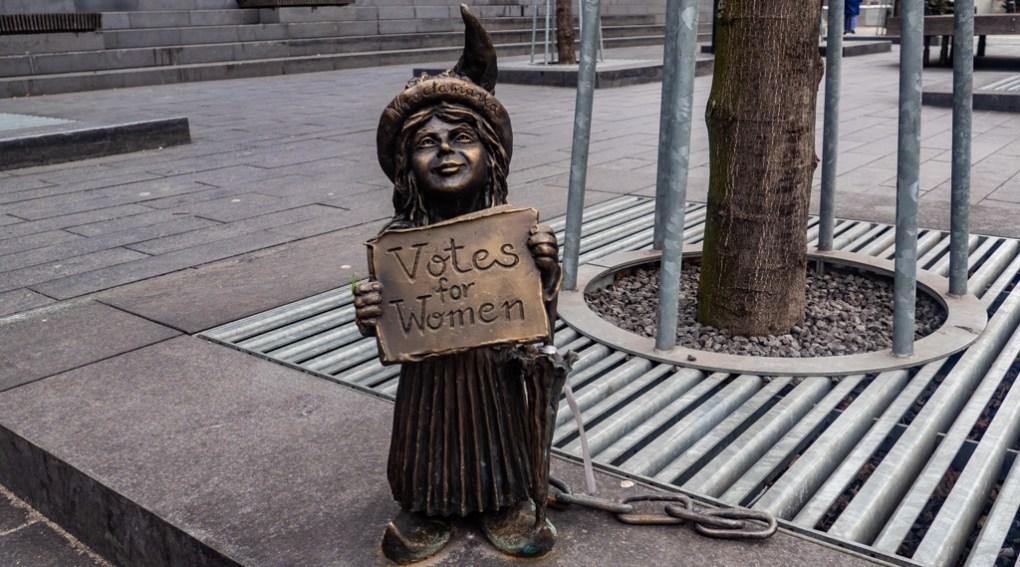 Wrocław Dwarf holding a 'votes for women' sign in Wrocław, Poland