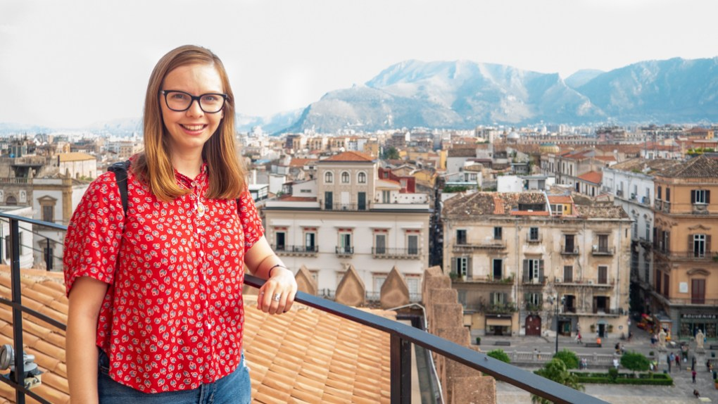 Almost Ginger blog owner on the roof of Palermo Cathedral with Palermo, Sicily in the background | 48 Hours in Palermo, Sicily Travel Guide