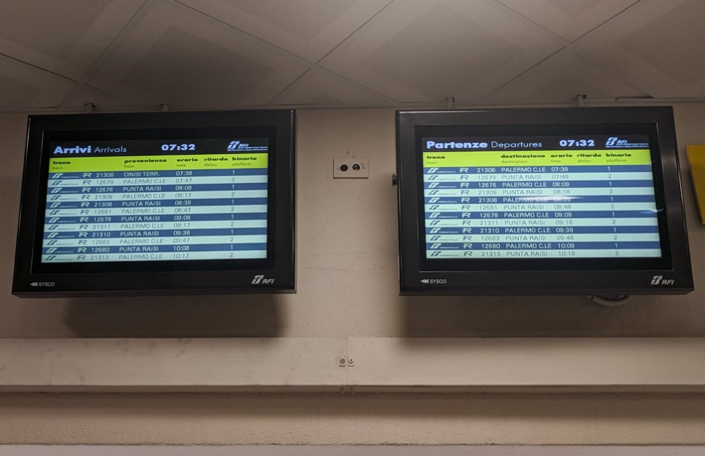 Departure boards at Palermo station in Sicily, Italy