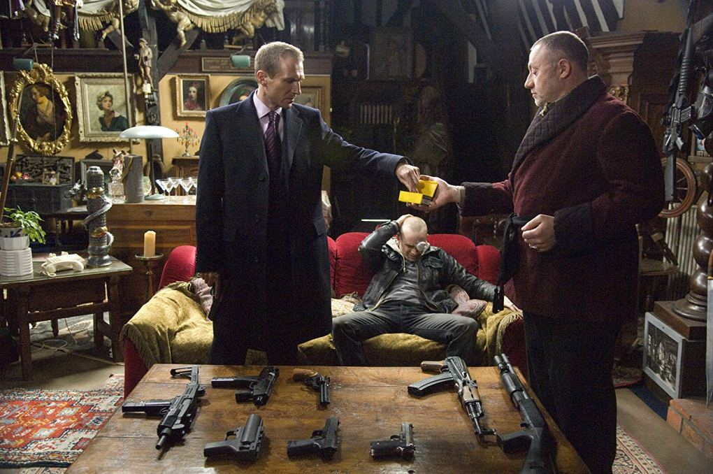 Harry (Ralph Fiennes) getting a gun in the film In Bruges