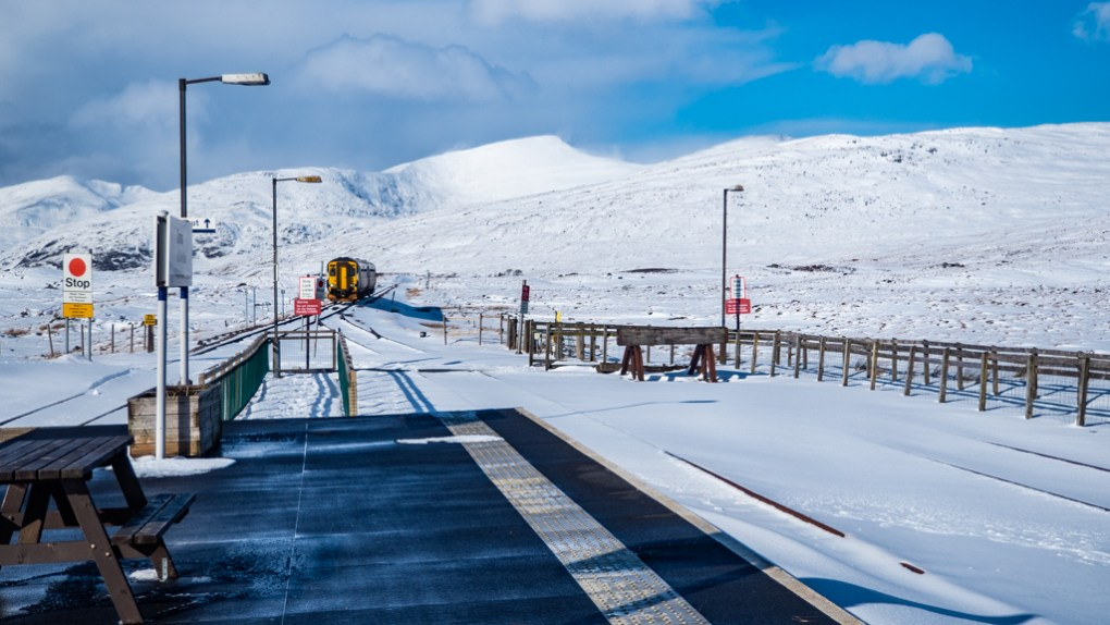 Train approaching Corrour Station in Rannoch Moor, Scotland