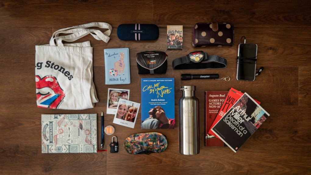 Flatlay of gear and essentials camp counsellors should pack for summer camp