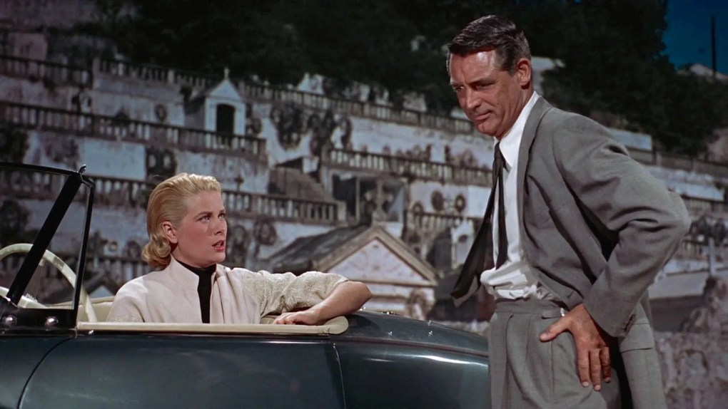 To Catch a Thief (1955) film still of Cary Grant and Grace Kelly in the convertible at the Cemetary in the French Riviera