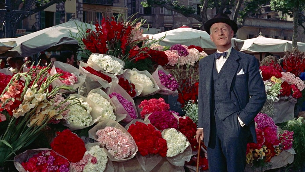 To Catch a Thief (1955) film still of the insurance man at Nice Flower Market in the South of France