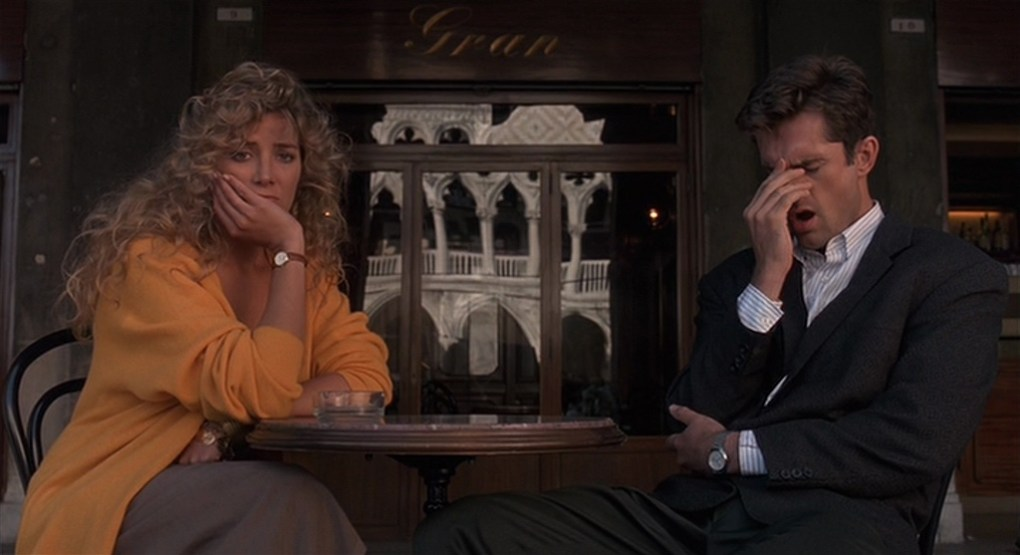 The Comfort of Strangers (1990) film still of two people sat at a table