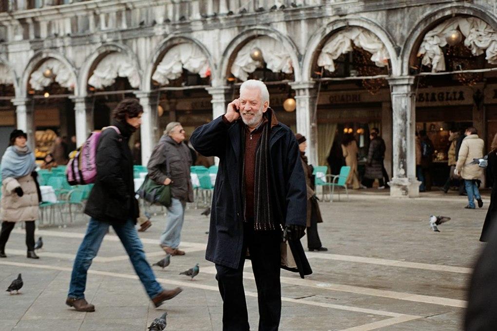 The Italian Job (2003) film still of Donald Sutherland in St Mark's Square in Venice, Italy