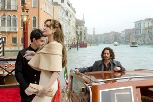 The Tourist (2009) film still of Angelina Jolie and Johnny Depp getting off a boat in the Venice Grand Canal, Italy