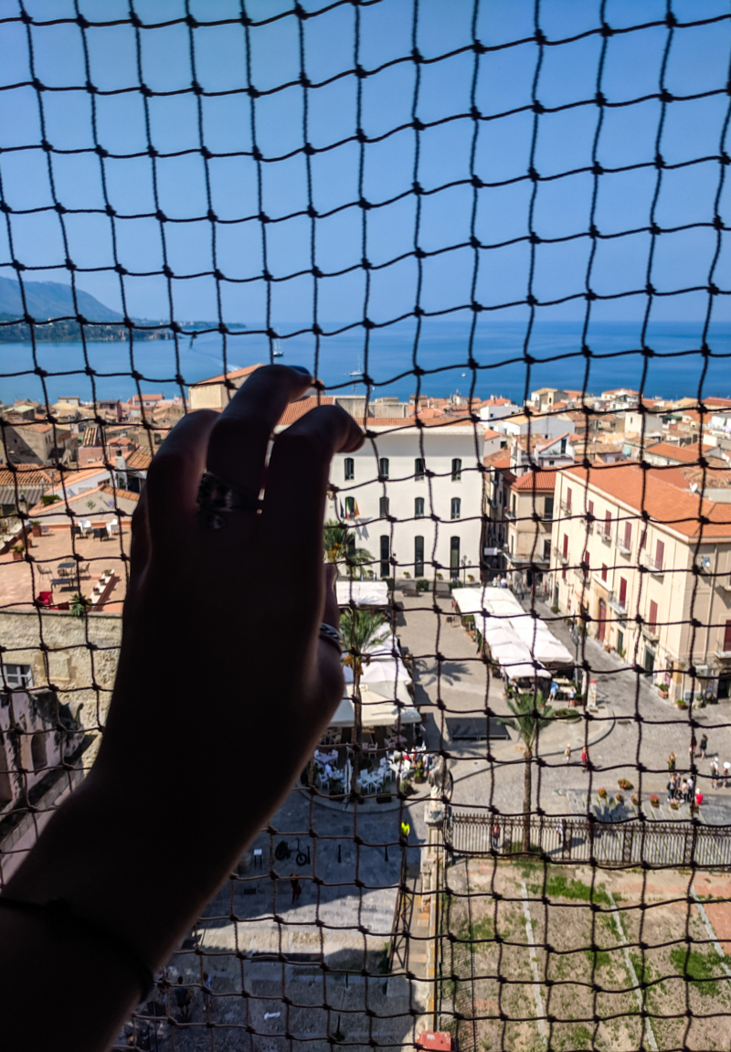 Netting covering the view over Cefalù, Sicily from the Cefalù Cathedral towers