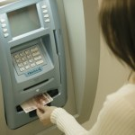 Woman Withdrawing Euros from Atm Machine