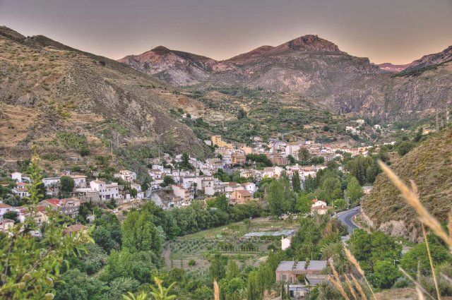 Monachil is a small village only 8 kilometres from Granada that offers beautiful views of the expansive Sierra Nevada mountains and a gateway to the canyon through which the Rio Monachil flows through.