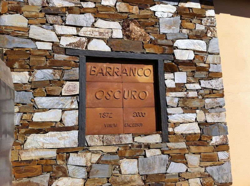 "This sign can be found on one of the houses at Barranco Oscuro. ""Vinum Excelsus"" is Latin and can be translated as ""wines made at high altitude""."