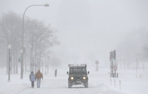 People walk during a winter storm on Pennsylvania Avenue in Washington